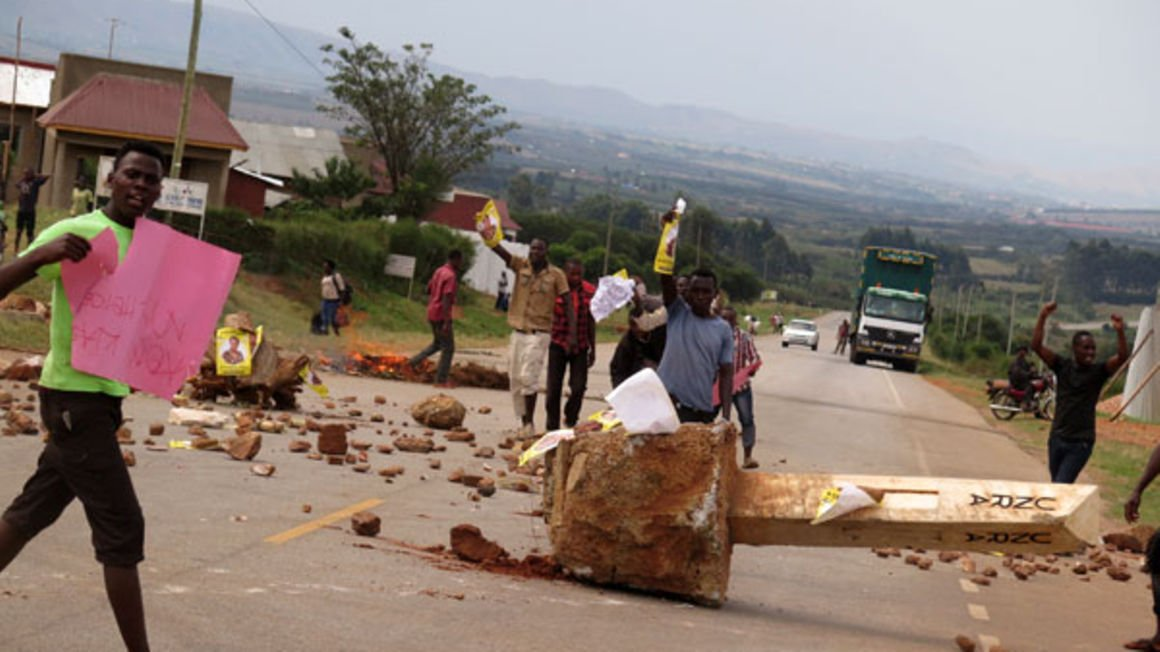 Youth block Ntungamo-Kabale road yesterday while protesting the recount of the Rushenyi County NRM vote. PHOTO | PEREZ RUMANZI